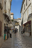 Porec ancient narrow street in Croatia Stock Photos