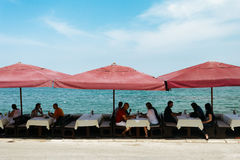 Porec, Croatia - July, 2016 - Cafe with sun umbrellas on the Adriatic coast in Porec, Croatia Stock Photos