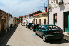Porec, Croatia - July, 2016 - Parked cars along a narrow street in a European city Royalty Free Stock Images