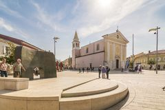 POREC, CROATIA, SEPTEMBER 24, 2017: People visit Church of Our Lady of Angels and taking time on Freedom Square. POREC, CROATIA, SEPTEMBER 24, 2017: People Stock Image