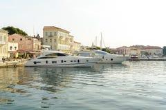 POREC, CROATIA, SEPTEMBER 24, 2017: Tourist walking on the Porec Marina dock and looking at the Luxury yacht. Royalty Free Stock Photography