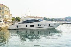 POREC, CROATIA, SEPTEMBER 24, 2017: Tourist walking on the Porec Marina dock and looking at the Luxury yacht. Royalty Free Stock Image