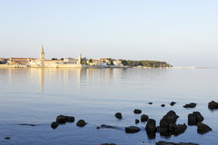 Porec in the dawn sun. Stones in the water Stock Photography