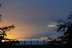 Pores do sol do tempo e do sol em Kastrup, Dinamarca imagem de stock