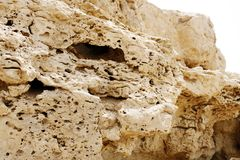 Pores visible in the outcrops of weathered limestone rock Royalty Free Stock Images
