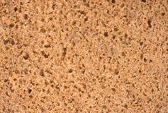 Poreuze textuur van bruin brood, besnoeiing grof Royalty-vrije Stock Foto's