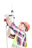 Porfessional builder using the drill machine Royalty Free Stock Photos