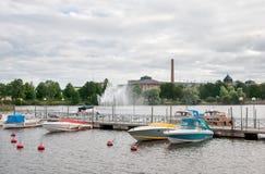 Pori. Finland. Pedestrian bridge and Porin Puuvilla Royalty Free Stock Image