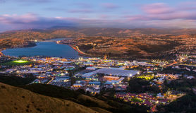 Porirua Sundown Lights. Looking over the city of Porirua, New Zealand as the sun goes down Stock Image