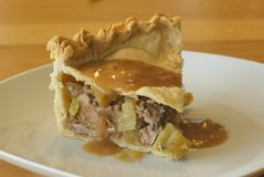 Pork, apple and cider pie Royalty Free Stock Photos