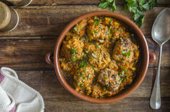 Pork and apple meatballs Stock Images