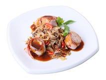 Pork in bacon with mushroom garnish Royalty Free Stock Photo