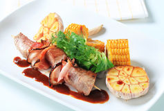 Pork and bacon skewer with garlic and sweetcorn Royalty Free Stock Photography