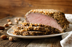 Pork baked in almond crumb. On a wood background royalty free stock photos