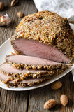 Pork baked in almond crumb Stock Photos