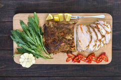 Pork baked ham, cutting slices with herbs, pepper kapi on the cutting board Royalty Free Stock Photography