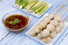 Pork ball. With sweet spicy sauce on blue wood table Stock Photography