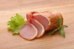 Pork balyk on the wooden board Stock Photos