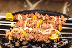 Pork barbecue  on grill with spices, closeup. Hot Pork barbecue  prepared on grill with spices, closeup Royalty Free Stock Photo