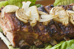 Pork barbecue with lettuce and onion stock photos