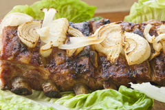 Pork barbecue with lettuce and onion royalty free stock image