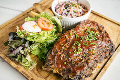 Pork bbq ribs with  coleslaw and salad. Pork bbq ribs with coleslaw and salad set meal Stock Photo