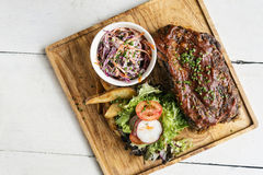 Pork bbq ribs with  coleslaw and salad. Set meal Royalty Free Stock Photo