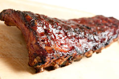 Pork bbq ribs, meaty ribs smothered with bbq sauce Royalty Free Stock Photos
