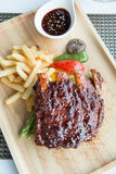 Pork bbq ribs, meaty ribs smothered with bbq sauce Stock Image