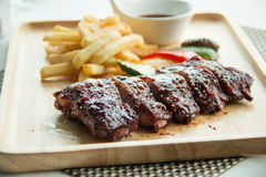 Pork bbq ribs, meaty ribs smothered with bbq sauce Royalty Free Stock Photography