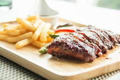 Pork bbq ribs, meaty ribs smothered with bbq sauce. A pork bbq ribs, meaty ribs smothered with bbq sauce royalty free stock images