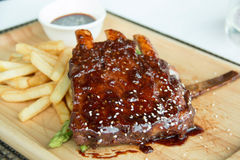 Pork bbq ribs, meaty ribs smothered with bbq sauce Royalty Free Stock Image