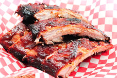 Pork bbq ribs. Meaty ribs smothered with bbq sauce Stock Photos