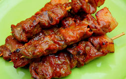 Pork BBQ. Streetfood from the Philippines; Pork BBQ Barbecue Pork, skewered pork parts that are marinated in a sweet and spicy sauce.(Food Preparation, Styling stock photography