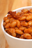 Pork and beans. Homemade BBQ pork and beans with bacon royalty free stock photo