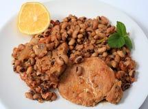 Pork and beans meal horizontal royalty free stock photos