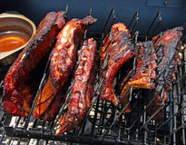 Pork and Beef Ribs. Smoking on the grill stock photos