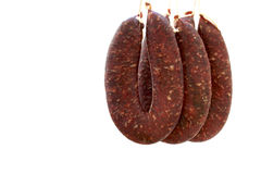 Pork and beef sausages hanged on hooks and waiting to get dry Stock Photos
