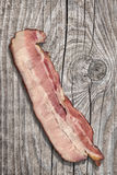 Delicious Gourmet Meaty Pork Belly Bacon Rasher Set On Old Knotted Pine Wood Picnic Table Stock Images