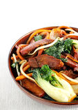 Pork and bok choy stir fry royalty free stock image