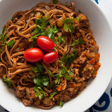 Pork Bolognese. With whole grain linguine and cherry tomatos Royalty Free Stock Photography