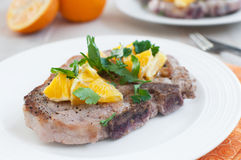 Pork bone-in chops with oranges and herbs Royalty Free Stock Photo