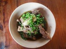 Pork bone soup. Braised pork Pork bone soup with coriander Stock Image