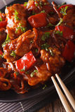 Pork braised in sweet and sour sauce with vegetables close-up. v Stock Photos
