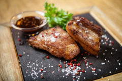 Pork breast on rib. Served with barbecue sauce stock image