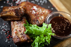 Pork breast on rib. Served with barbecue sauce royalty free stock photography