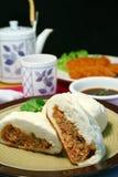 Pork buns. Steamed and fried oriental pork buns stock photos
