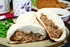 Pork buns. Steamed and fried oriental pork buns royalty free stock images