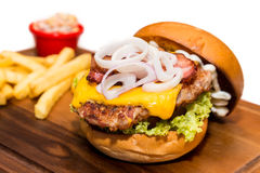 Pork burger with cheese, vegetable and served with fries Royalty Free Stock Photography