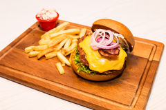 Pork burger with cheese, vegetable and served with fries Royalty Free Stock Photo